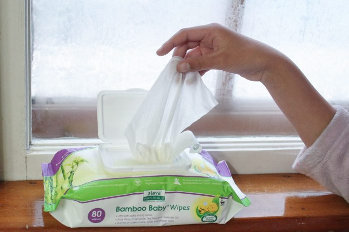 Hand taking Bamboo Bay Wipes from the package.