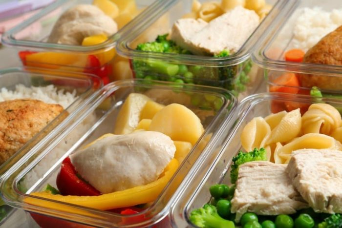 Plastic containers with prepared meals