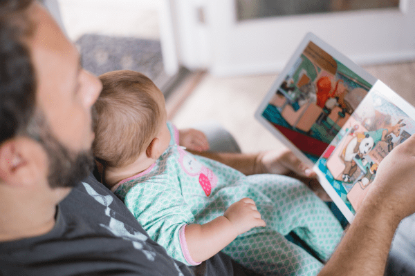 Man reading to a baby