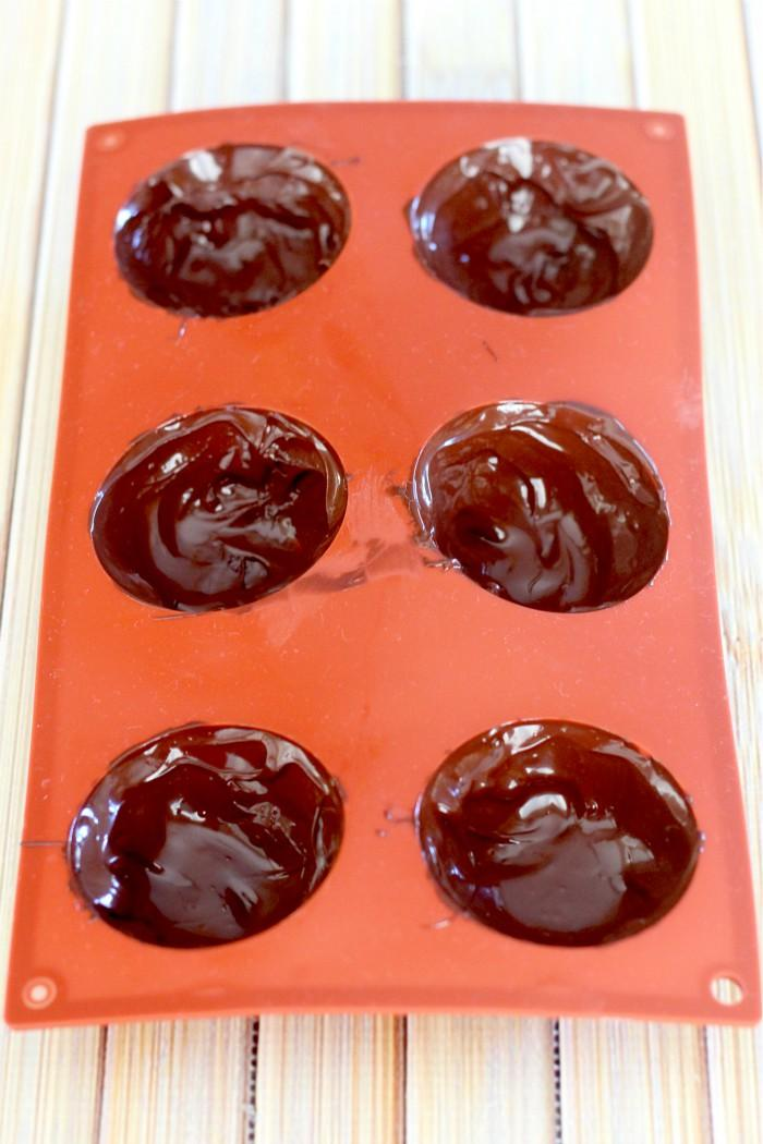 chocolate melted in the silicone hot chocolate bomb mold
