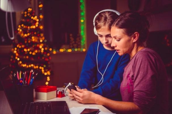Girl and woman listening to audiobooks