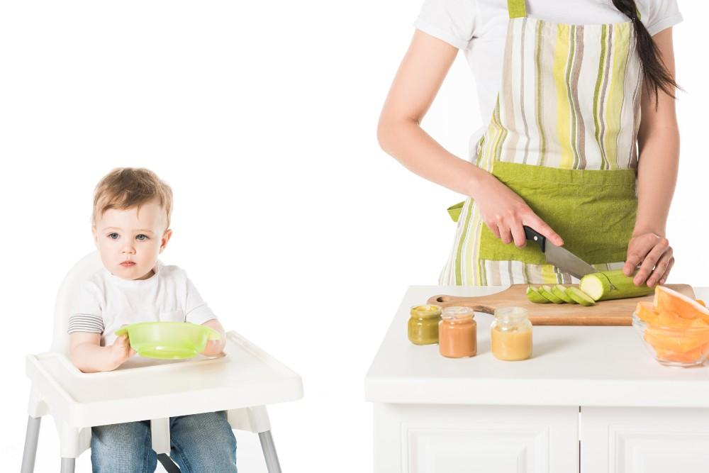 Woman preparing a meal for a baby