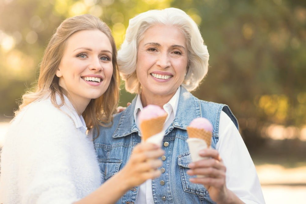 Grandmother and grand daughter having an ice cream cone