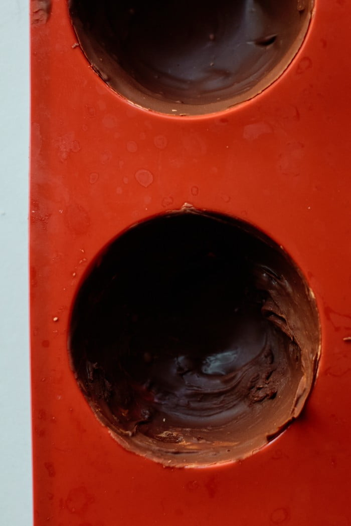 melted chocolate chips in a chocolate sphere