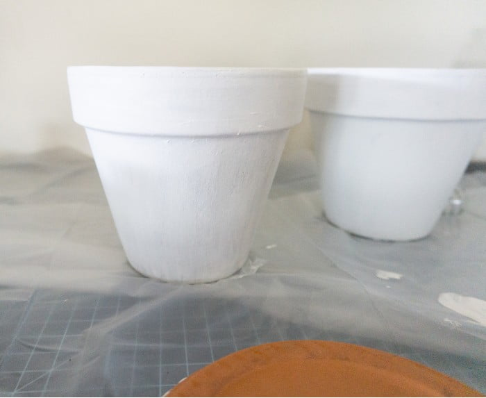 Terra cotta pots painted in white