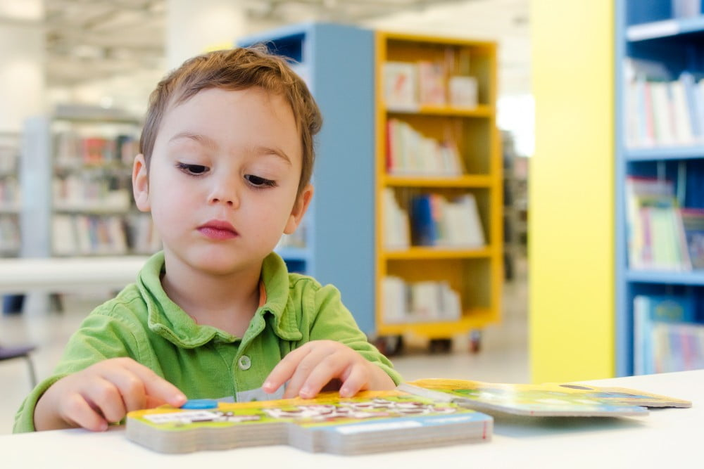 toddler at the library